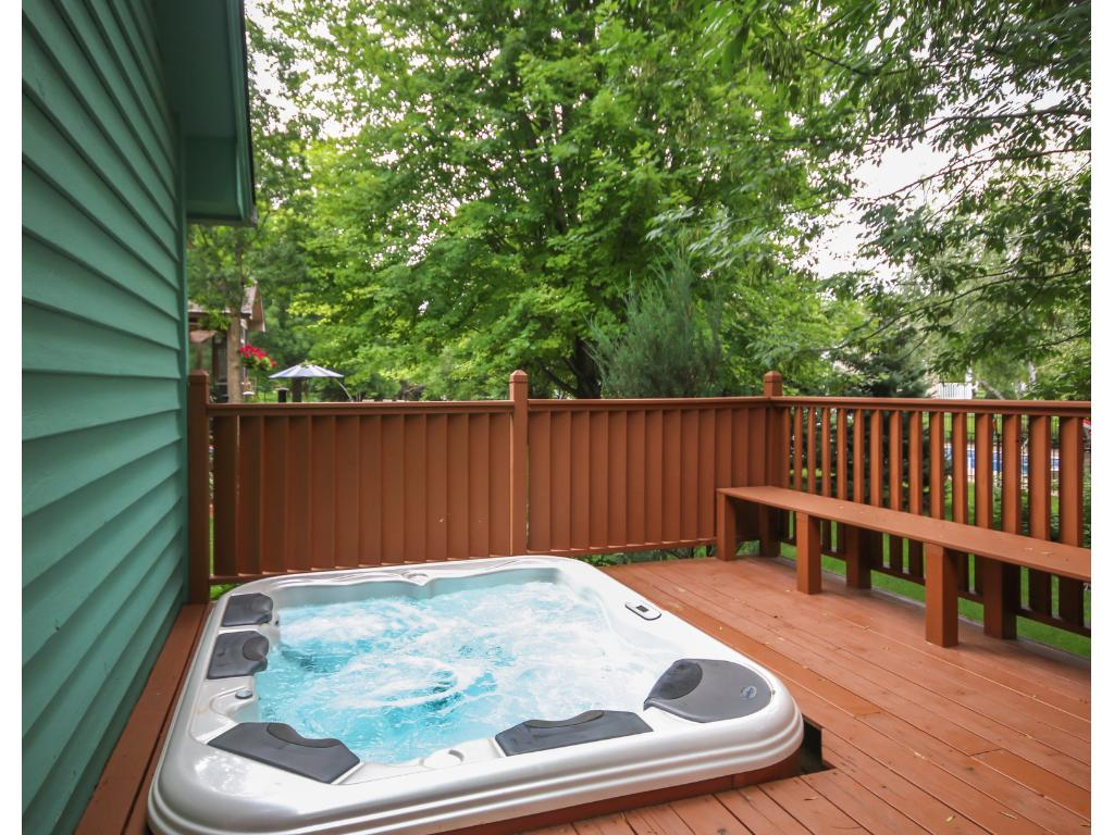The relaxing backyard deck is sure to be a favorite! Sit back and enjoy the fresh air and this beautiful hot tub!