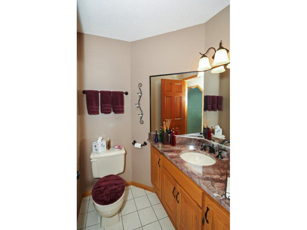 All baths are updated with new tile and granite counters.