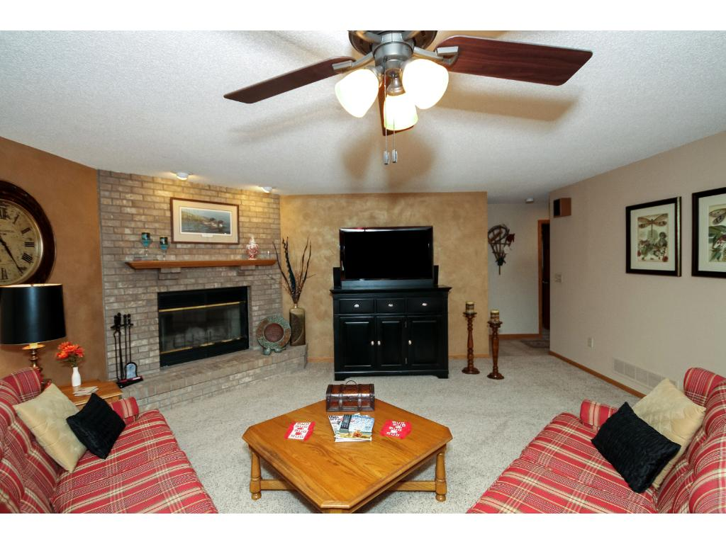 On the lower level you will find this cozy spot - the family room. Complete with a stone fireplace.