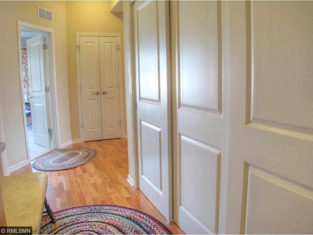 Extra large wall of closets in foyer.