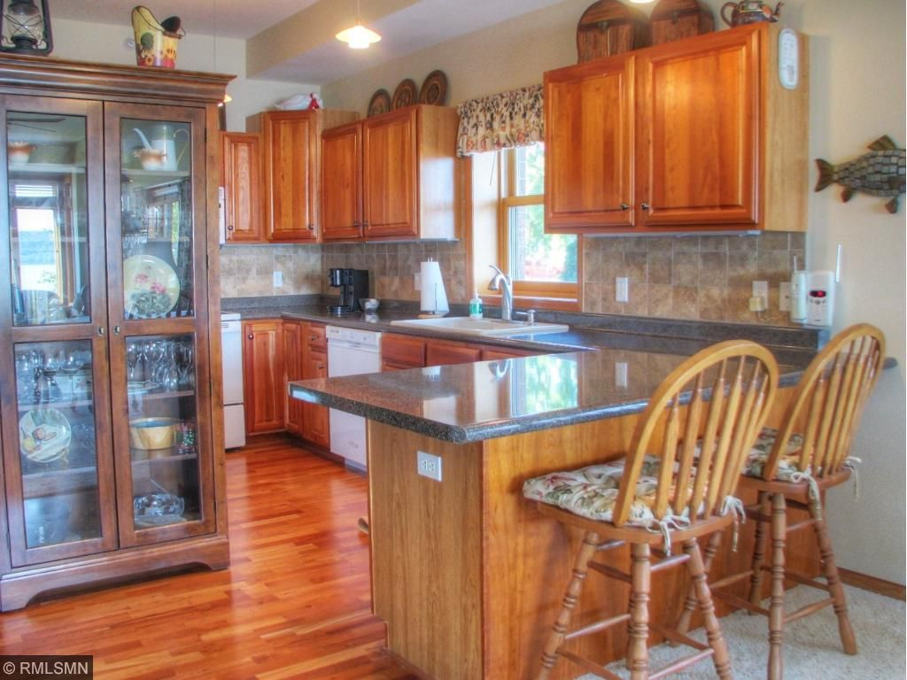 Kitchen with Cherrywood Cabinets & cherry hardwood floors.