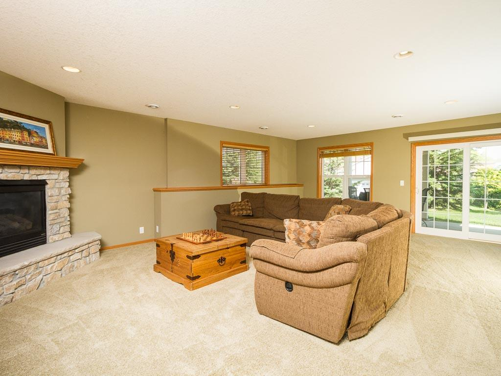 Lower level amusement/family room with second gas burning fireplace.
