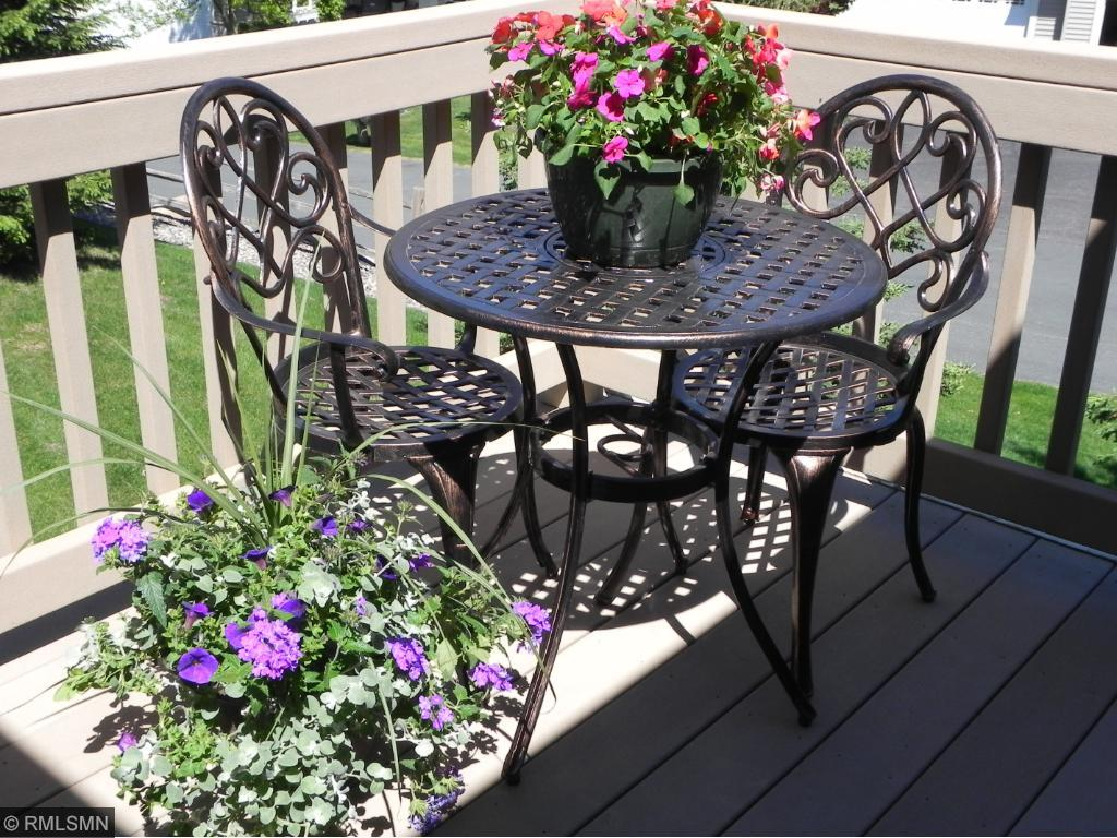 Maintenance free deck off of the sunroom on the main level.