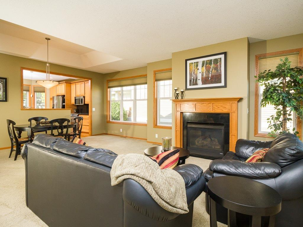 Tastefully decorated living areas with main level granite finished gas fireplace.