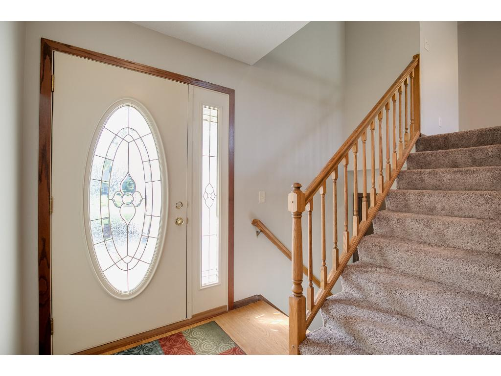 Very inviting foyer with a beautiful front door!