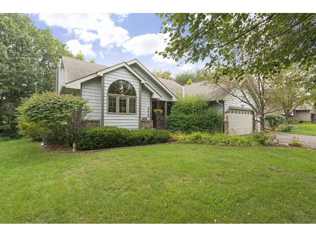 Welcome home to 9029 Pinehurst Road! This meticulous family home is nestled in a private and serene Woodbury neighborhood.