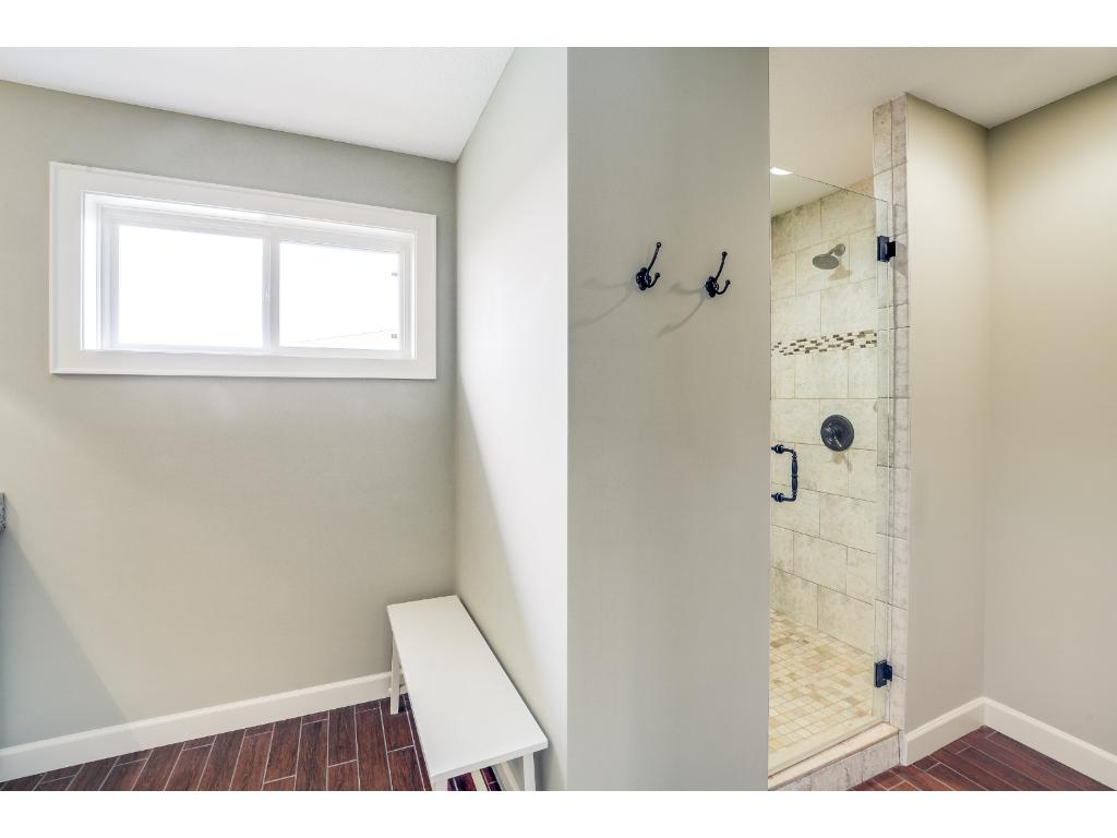 Walk-in shower in the private master bathroom with dual shower heads!