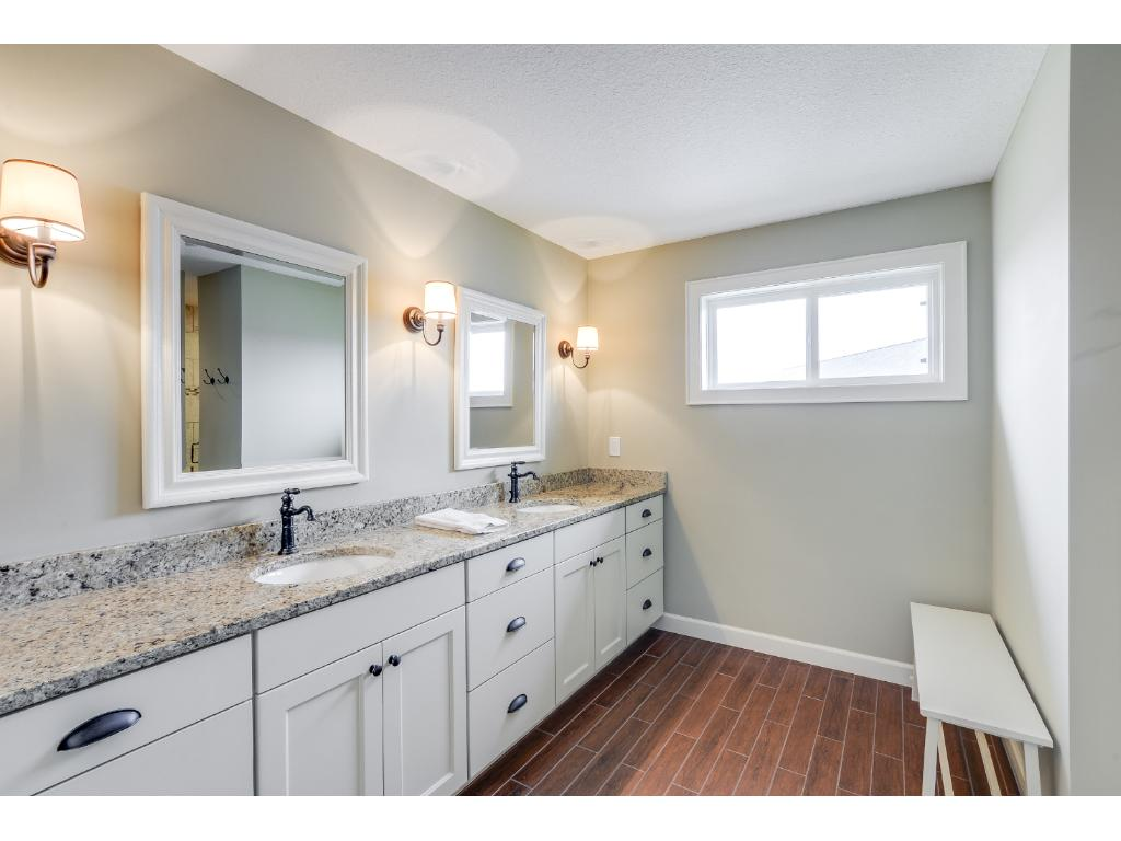 Master bathroom with dual sinks, and a walk-in shower with dual shower heads!