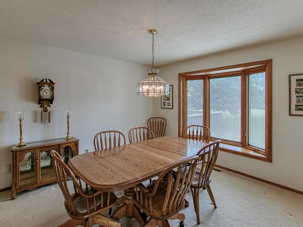 Formal dining room with bay window overlooking golf course