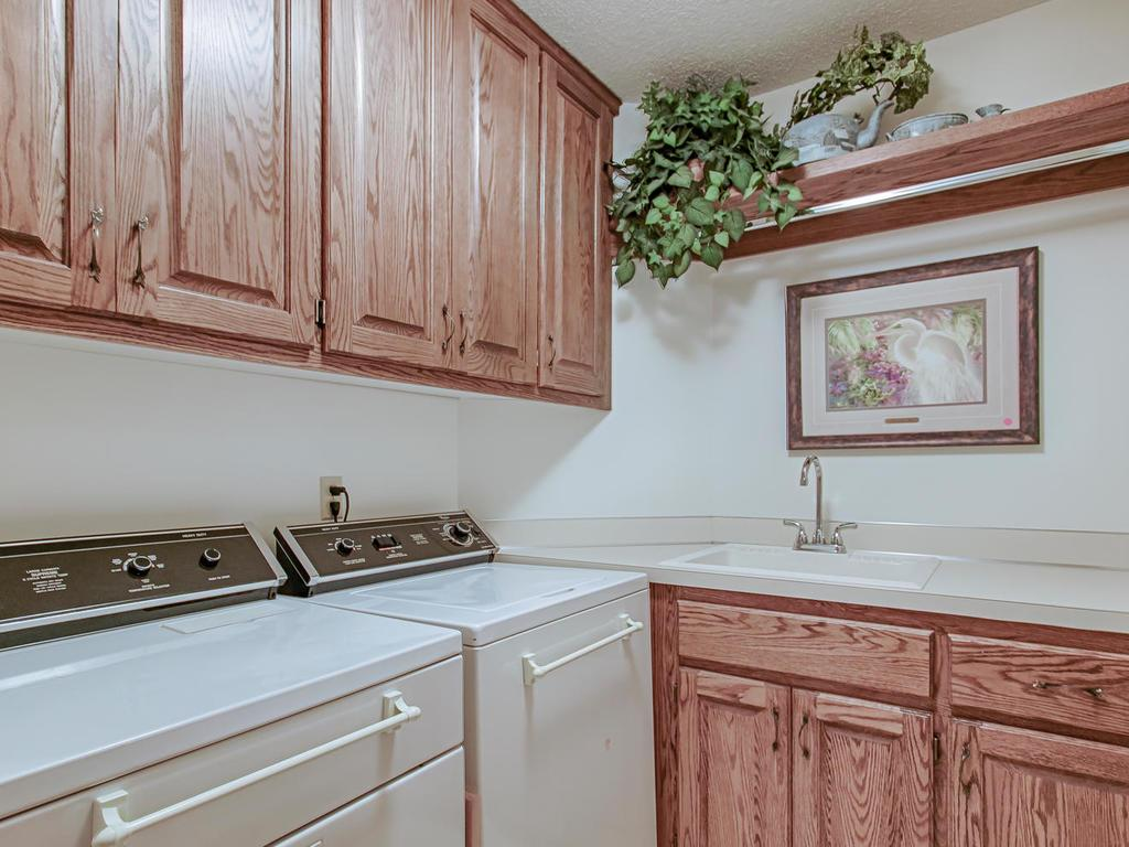 Clean laundry room with tons of storage