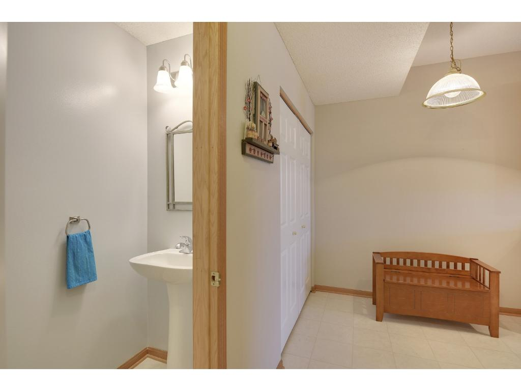 Main floor powder room plus informal dining area or mud room space with garage access