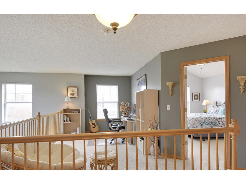 Loft space is perfect for family room, office or play zone