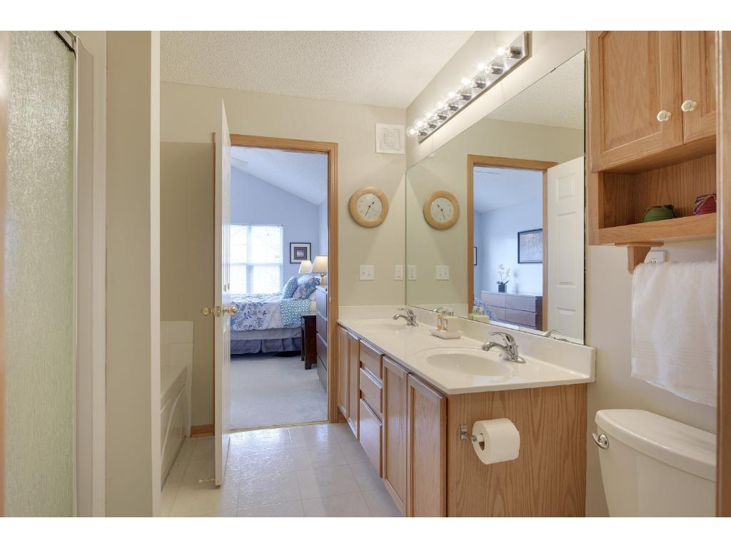 Master bath features double vanity, separate shower and tub