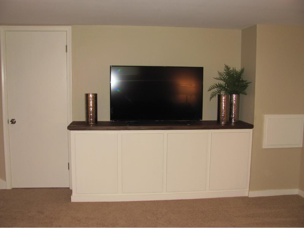 Added storage and cabinet for the big screen TV. To the left is a storage closet.
