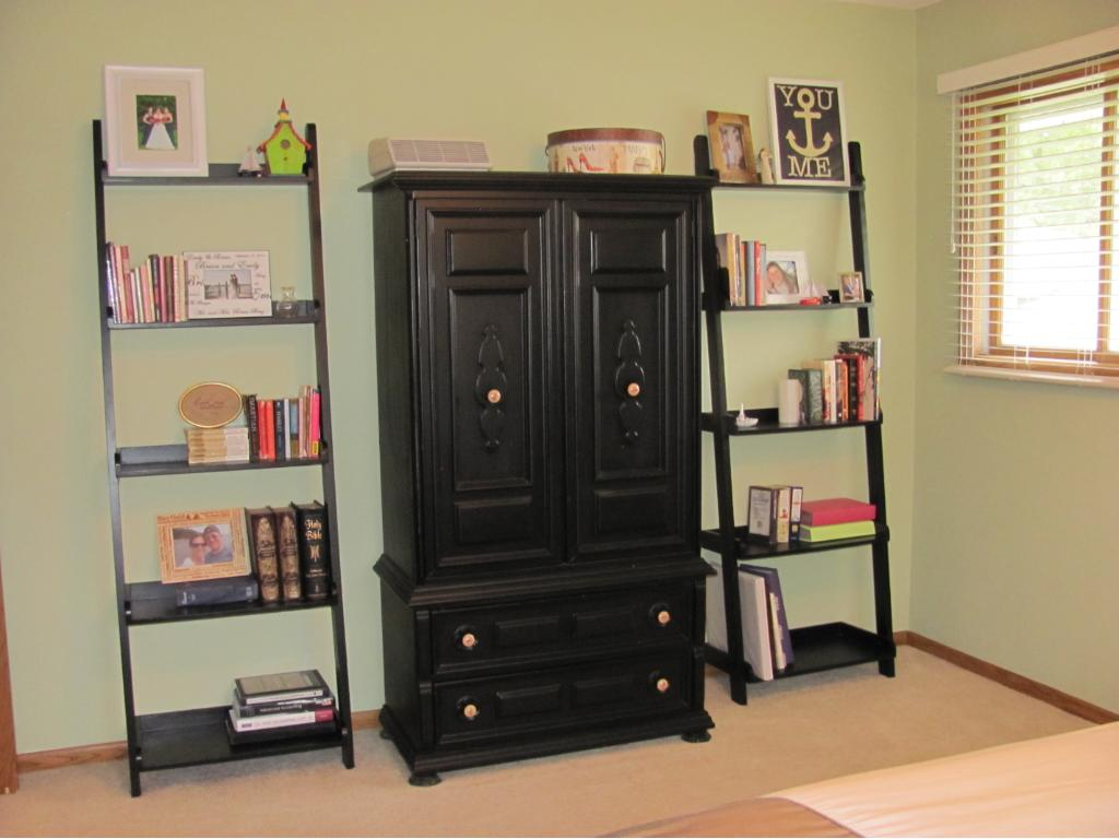 Another view of the spacious master bedroom with a double closet and ceiling fan/light combo.