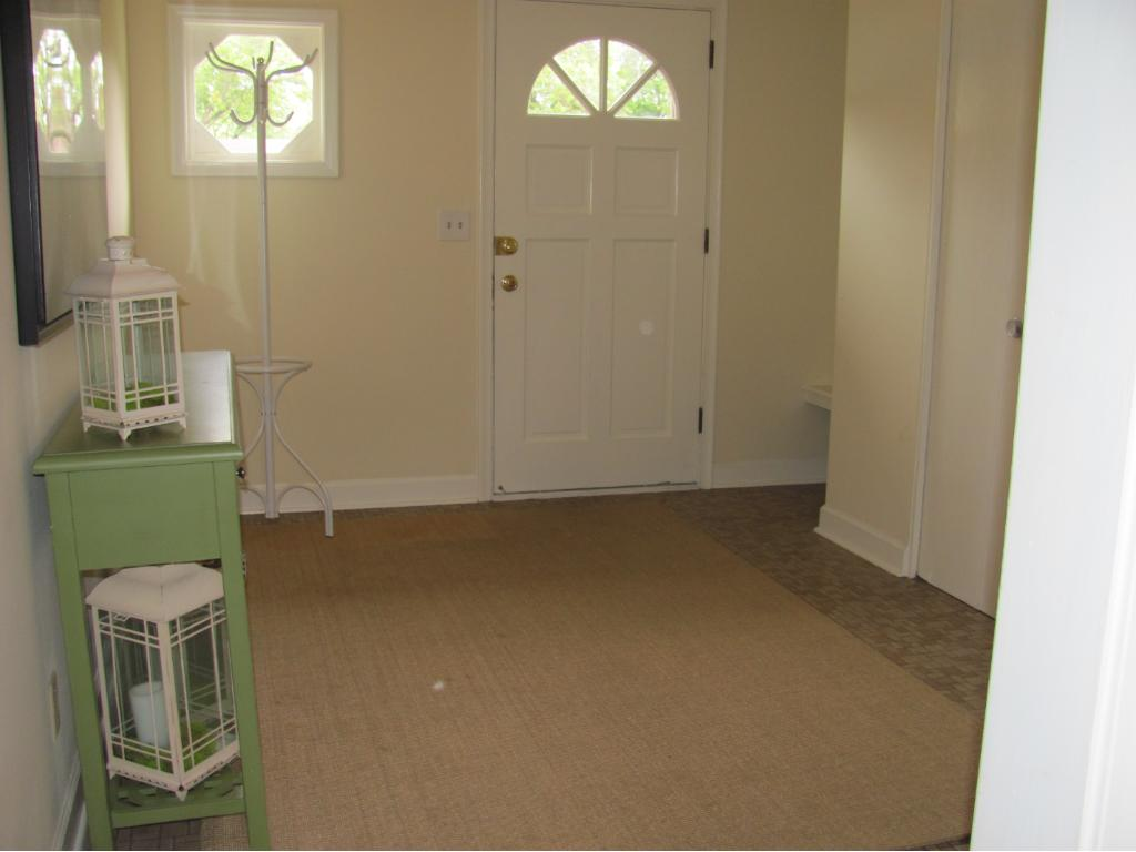 Huge CT entryway with a double closet and space for an entry table or bench.