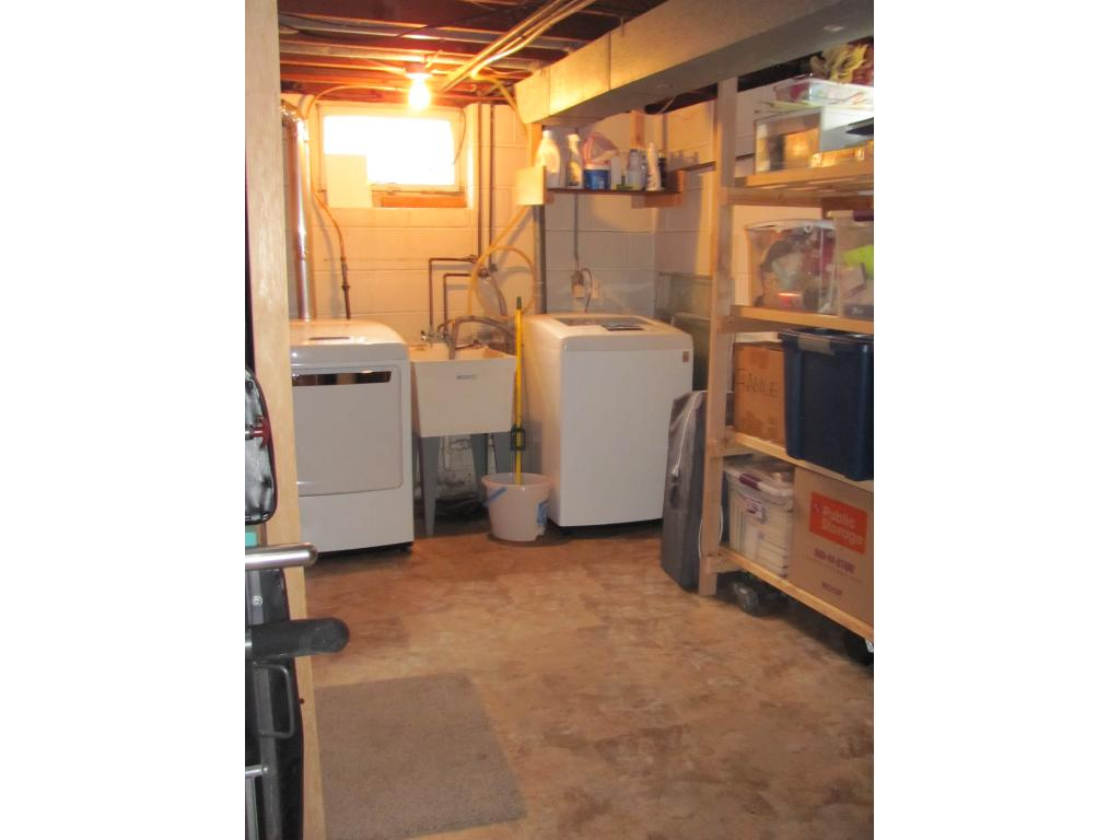 "Laundry room with high end LG washer and dryer. Sturdy shelving for all your ""stuff""."