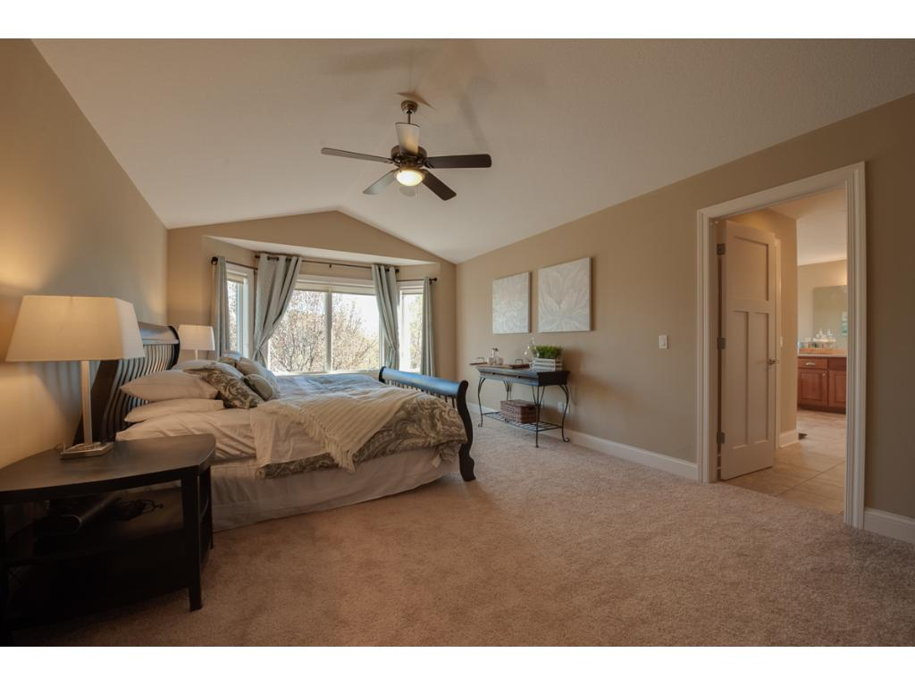 The owner's bedroom features new carpet and surround sound speakers.