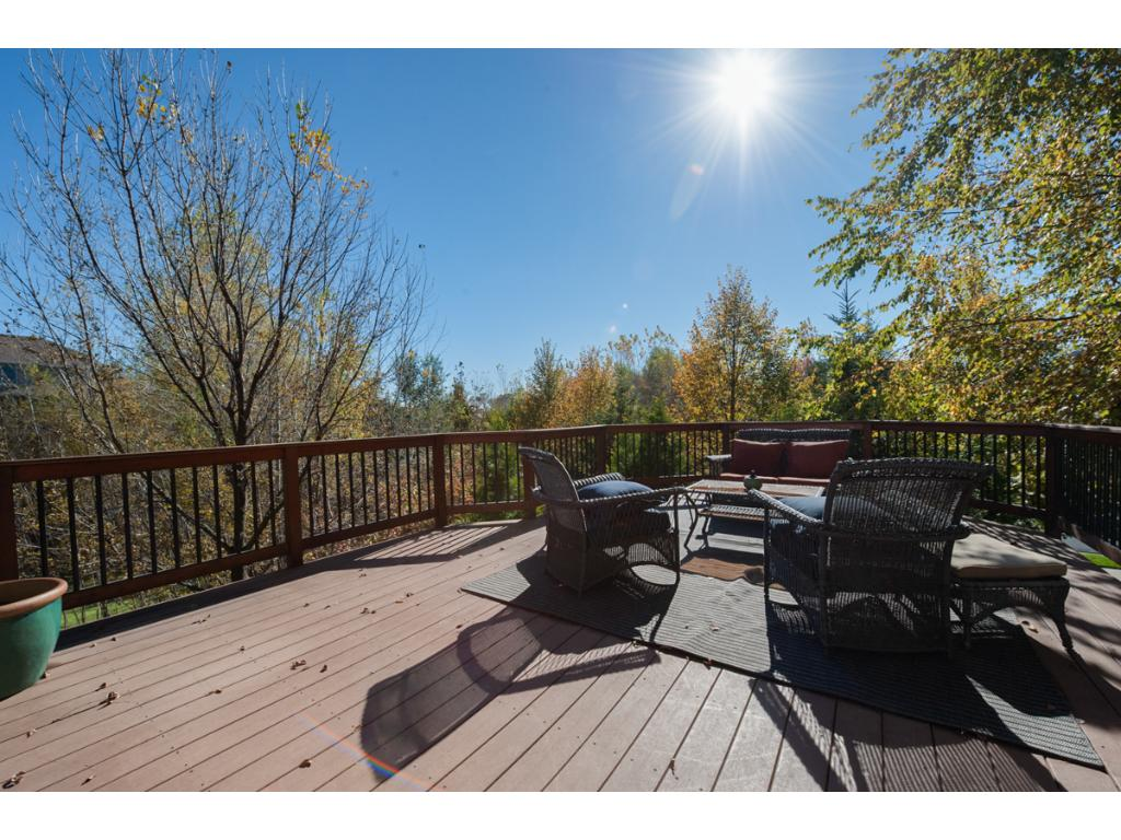The spacious maintenance-free deck is accessible from the back yard or the informal dining area inside the home.