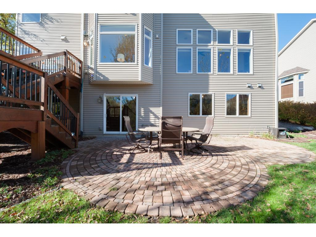 A beautiful paver patio at the base of the deck stairs provides another option for dining or enjoying nature.