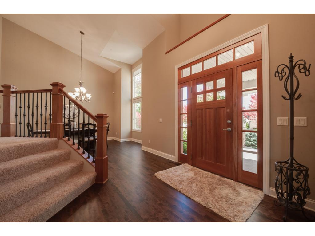 The foyer is impressive, with an 18' vaulted ceiling and recently refinished cherry floors.