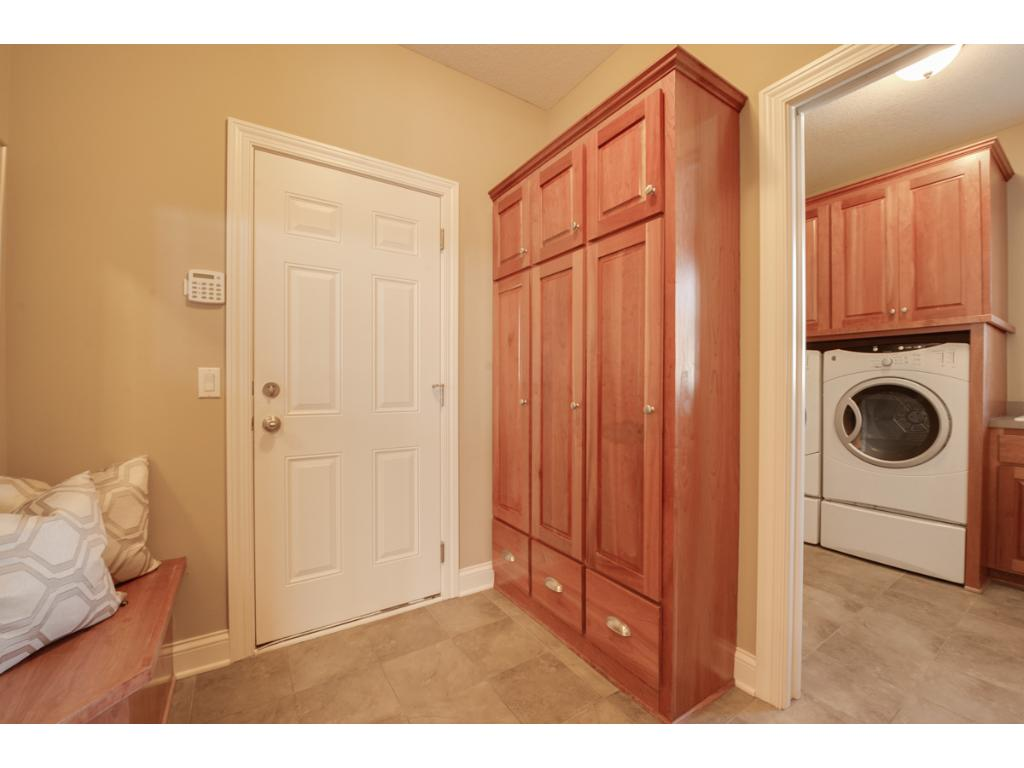 The large mudroom is complete with a bench and cubbies, as well as a large coat closet.