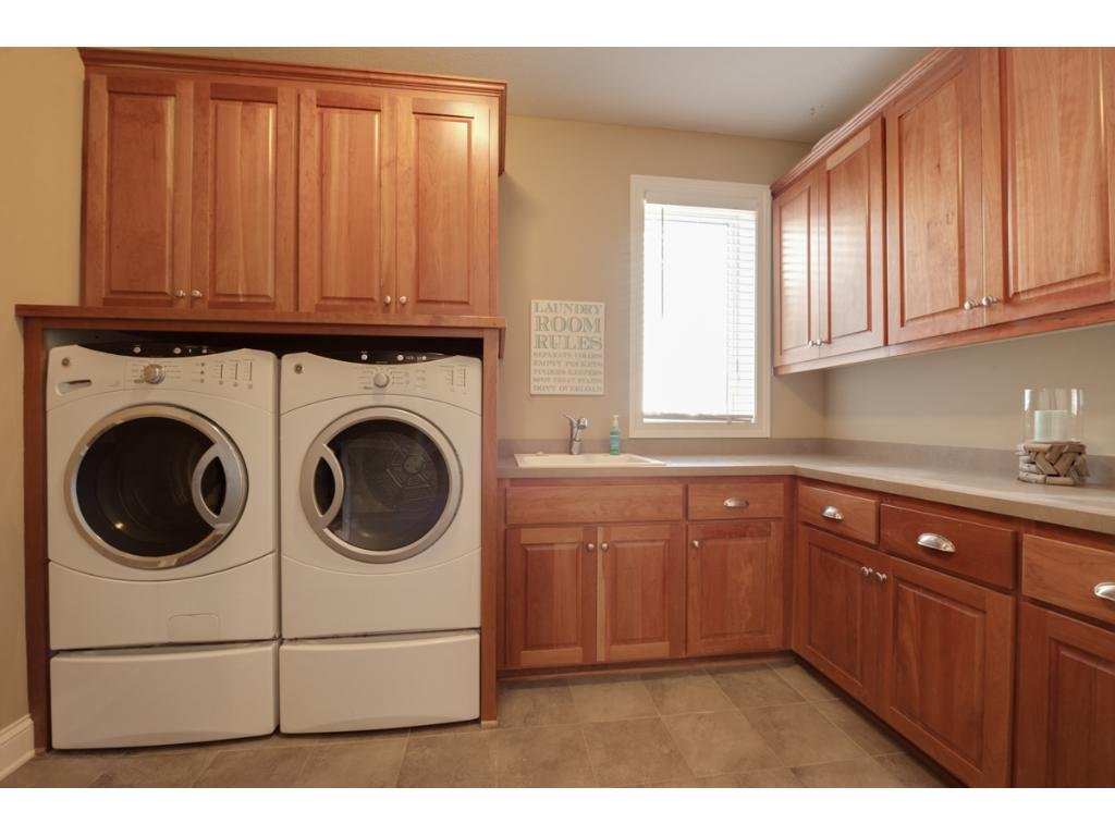 If you have to do the laundry, this is a great room for it - light and bright with copious amounts of storage and counter space!