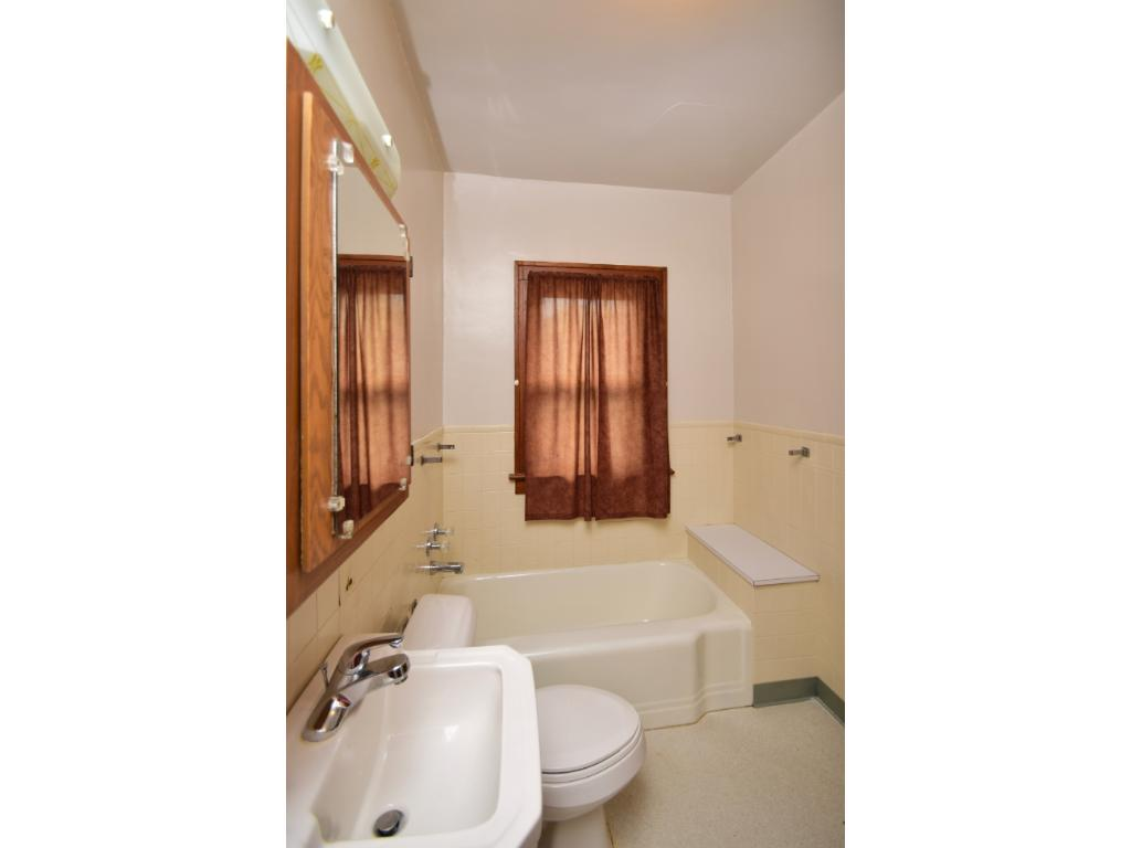 Main level bathroom with separate tub/shower.