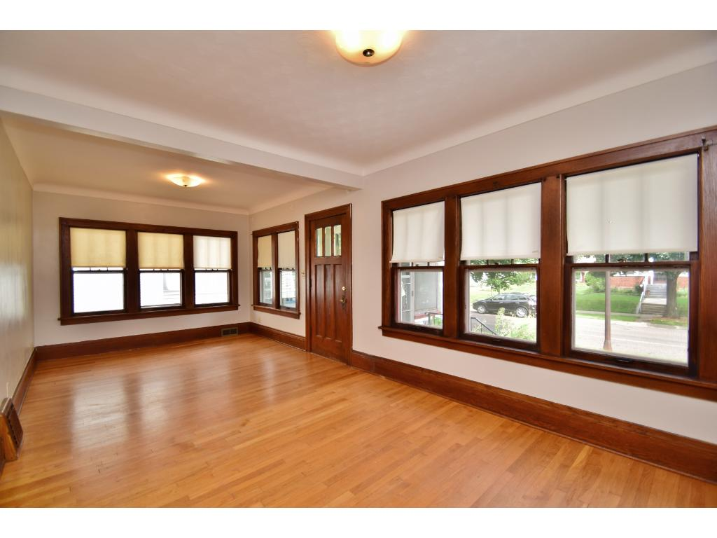 Very large living room with lots of natural lighting and high ceilings throughout.