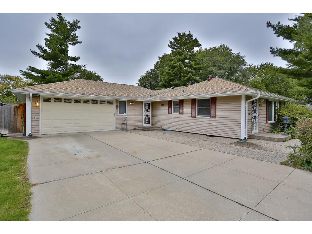 9124 Bloomington Ave. has a concrete driveway & over sized 2 car garage, maintenance Free siding and newer roof.