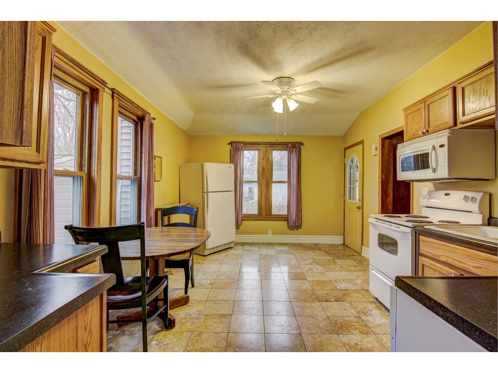 The warm yellow colors and gleaming tile floors of the kitchen.