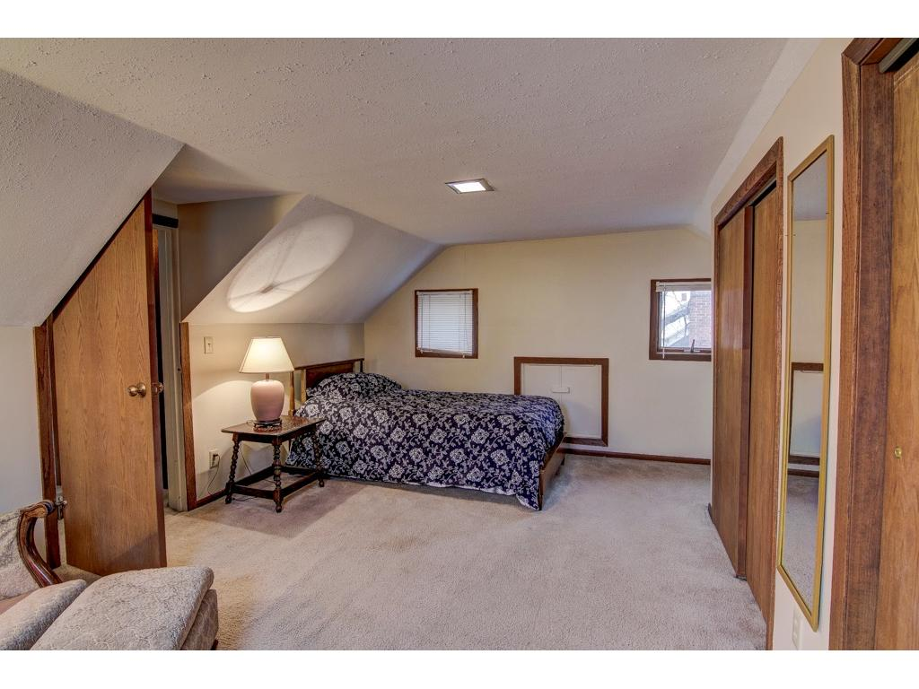 The south upstairs bedroom has two double closets and ample room for a quiet reading area as well.