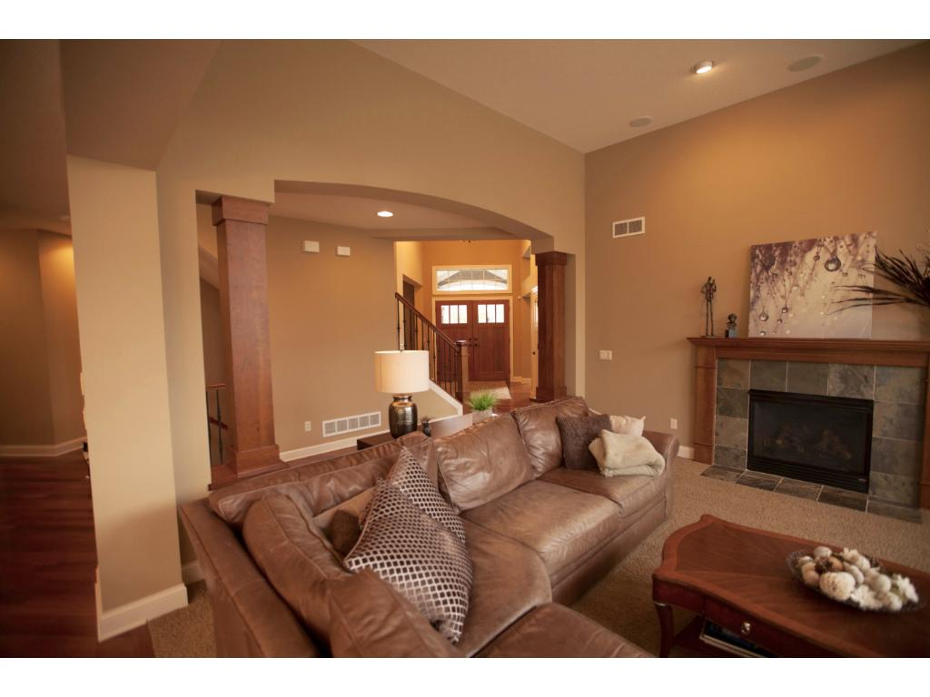 Another view of main floor family/great room with fireplace and view to the front foyer.