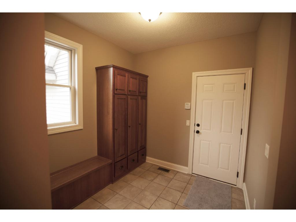 Mudroom off of garage also has a walk-in closet area.