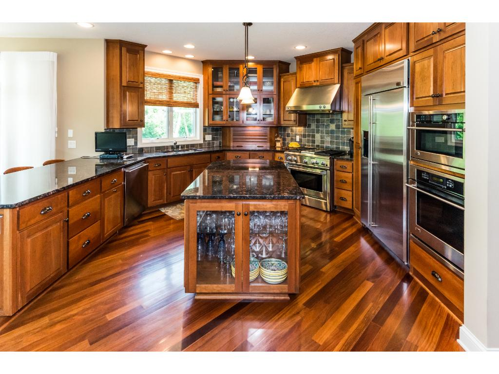 Large open kitchen with high-end stainless steel, GE Monogram appliances & center island.