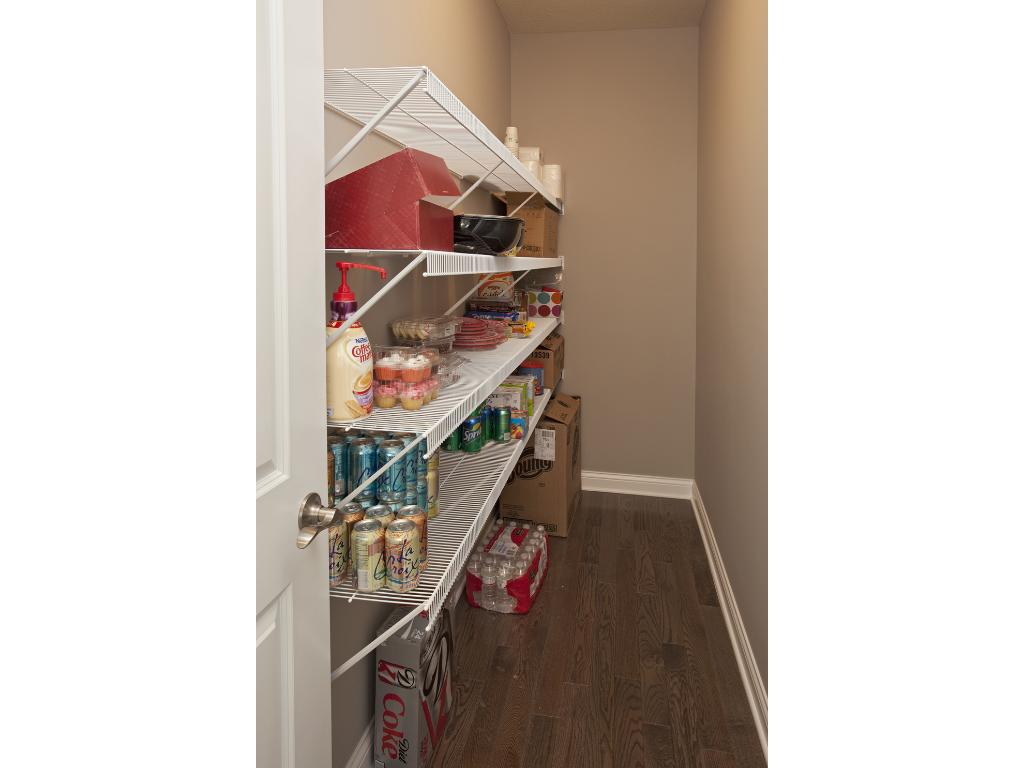 Photo of a Model Home. Walk-in pantry.