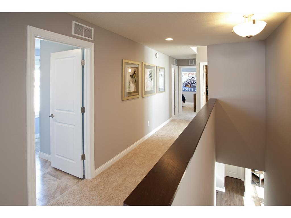 Photo of a Model Home. Upstairs hallway