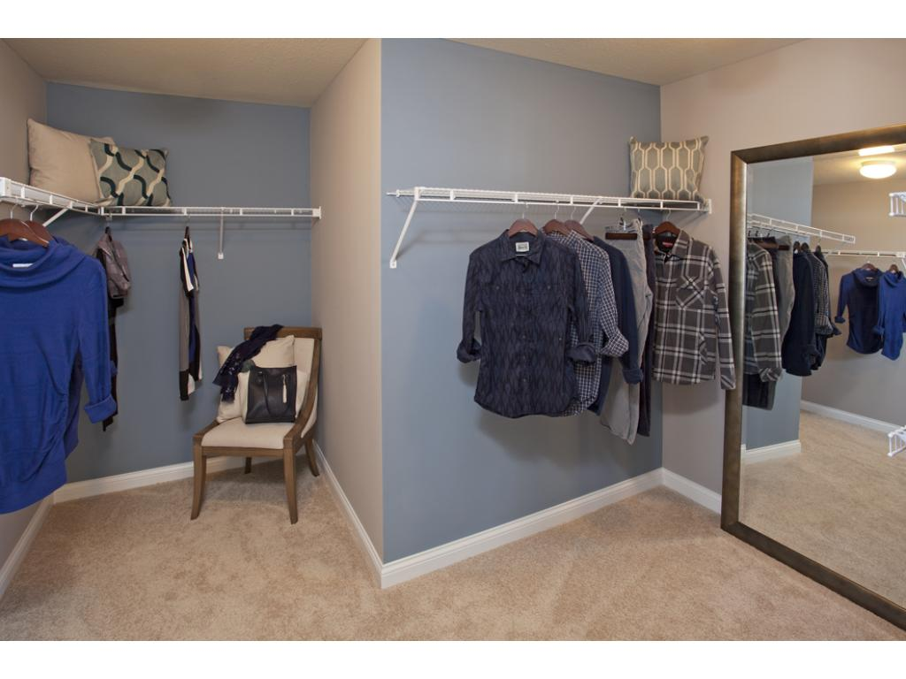 Photo of a Model Home. Master walk-in Closet