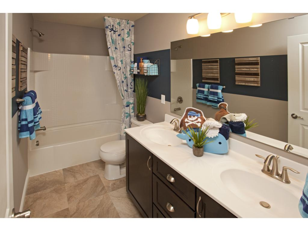 Photo of a Model Home. Secondary full bathroom