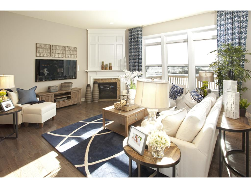 Photo of a Model Home. Gathering Room with 11' ceiling and oversized windows