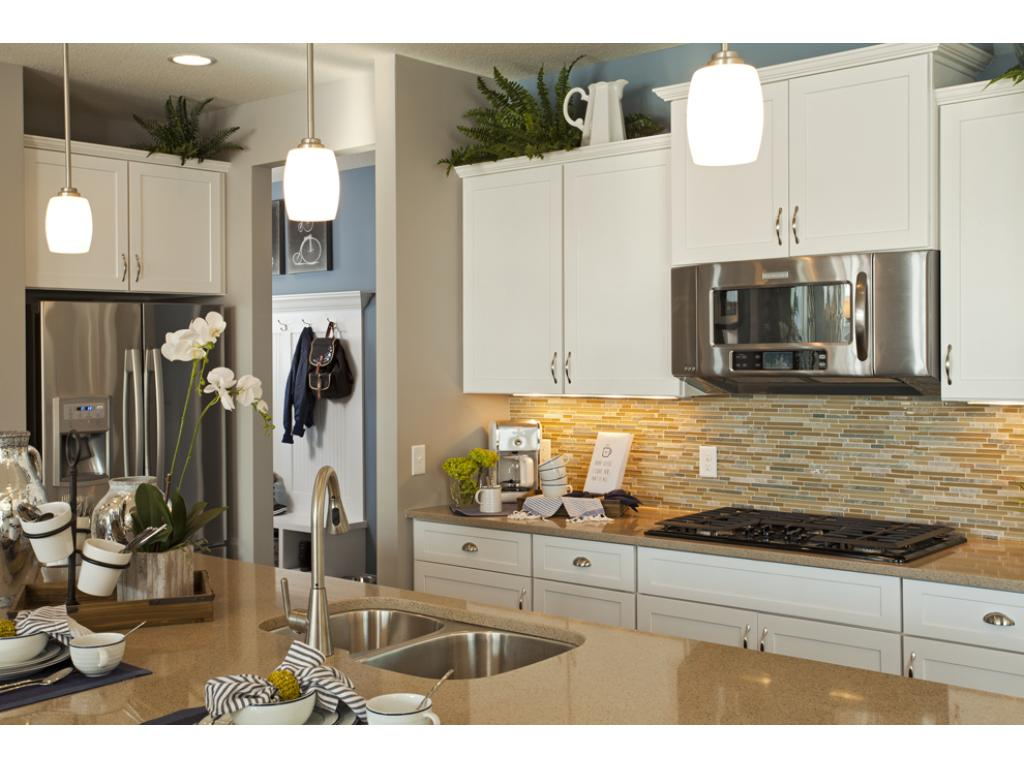Photo of a Model Home. Gourmet kitchen