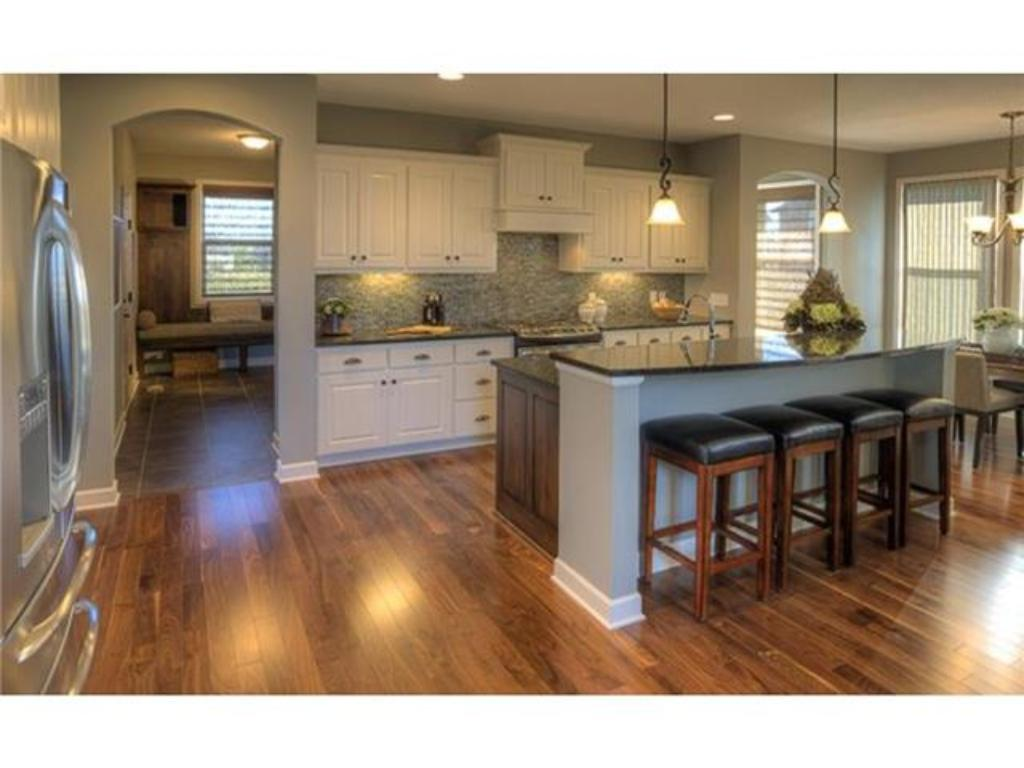 Gourmet Kitchen, custom cabinets, solid wood floor. Breakfast room with the most beautiful view!