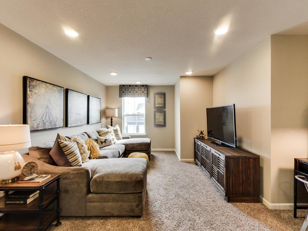 This in demand game room area is a must have for todays homes. Notice how big the space is! A perfect hang-out spot for all the residents of the home. Photo of a finished model, actual home may differ.