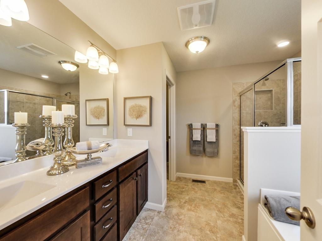 Beautiful owners suite provides the ideal retreat with private bath, walk in closet, separate tub and shower, double vanity and private water closet. Finished model actual home may differ.