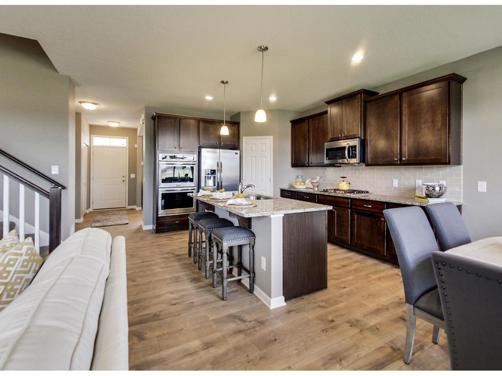 The kitchen is such an important aspect of modern homes, it is where we come together and often an area we entertain.  The granite island creates a great gathering place with true eat in capabilities. Photo of a finished model actual home may differ.