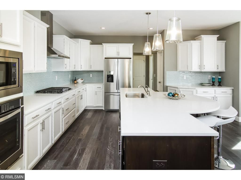 Huge Gourmet Kitchen with Quartz countertops, SS appliances, and plenty of cabinets!