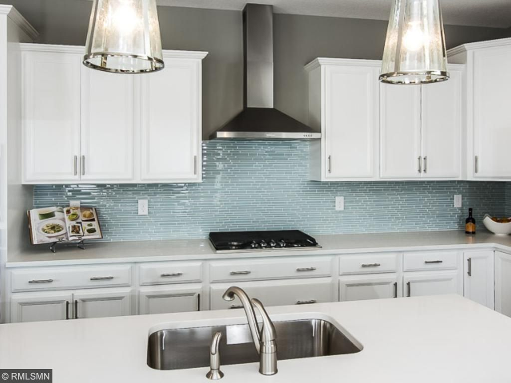 Gas Cook top, beautiful backsplash.