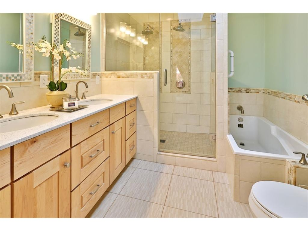 The new Master Bath has a wonderfully spacious walk-in shower, tile floors, double vanity, a tub and new skylights.