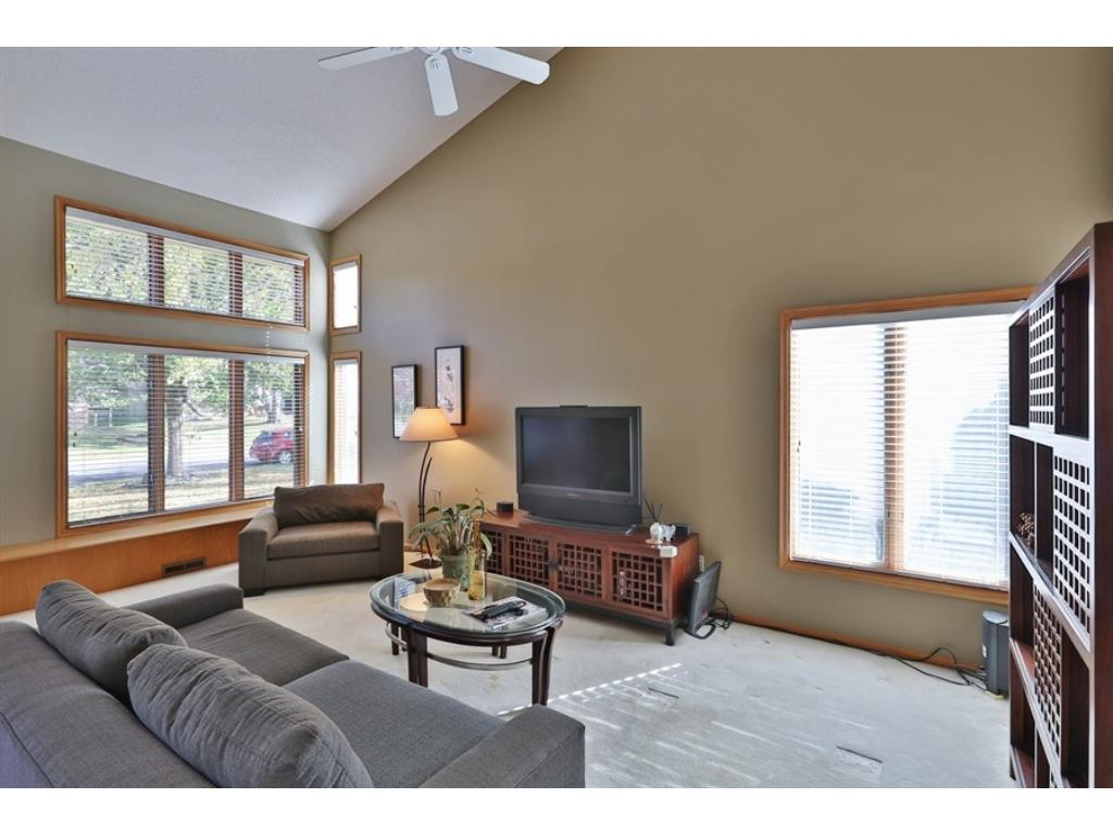 A 2-story Living Room with spacious vaults and plenty of natural sunlight.