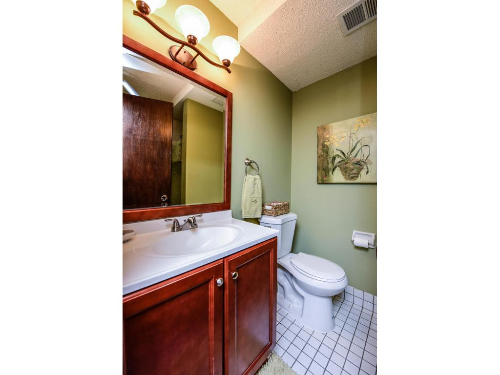 Recently updated lower level bathroom with new vanity, mirror, light fixtures and sink!